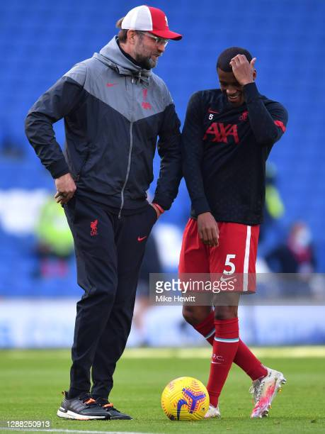 Jurgen Klopp, Manager of Liverpool talks to Georginio Wijnaldum during the warm up prior to the Premier League match between Brighton & Hove Albion...