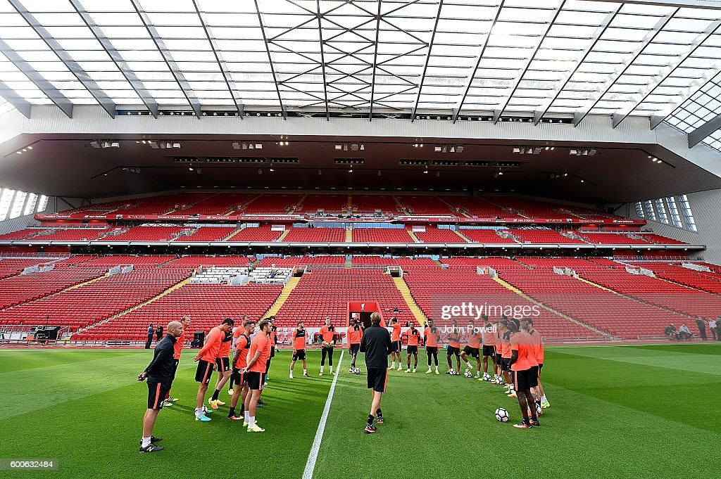 Jurgen Klopp manager of Liverpool talks to his team during a training session at Anfield on September 8, 2016 in Liverpool, England.