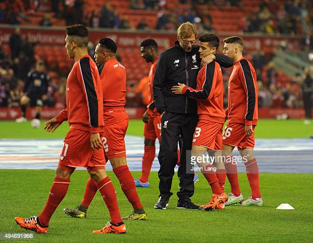 Jurgen Klopp manager of Liverpool talks to Joao Teixeira of Liverpool before the Capital One Cup Fourth Round match between Liverpool and AFC...