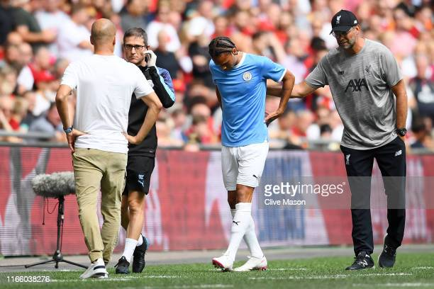 Jurgen Klopp Manager of Liverpool talks to Leroy Sane of Manchester City as he leaves the pitch with an injury during the FA Community Shield match...