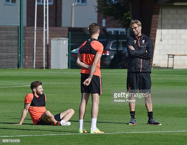 Jurgen Klopp manager of Liverpool talks with Adam Lallana and Jordan Henderson during a training session at Melwood Training Ground on September 22...