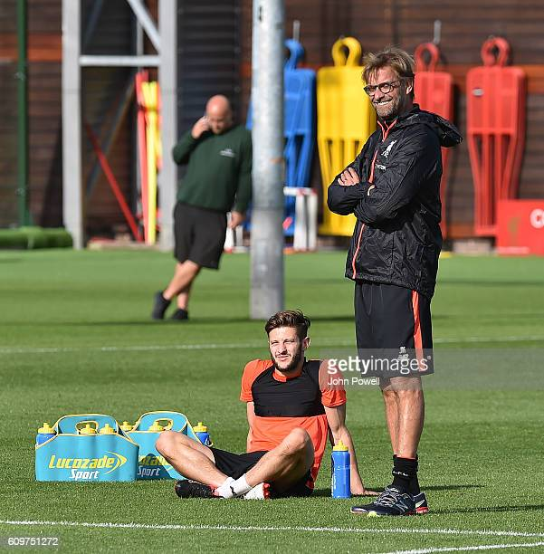 Jurgen Klopp manager of Liverpool talks with Adam Lallana during a training session at Melwood Training Ground on September 22 2016 in Liverpool...