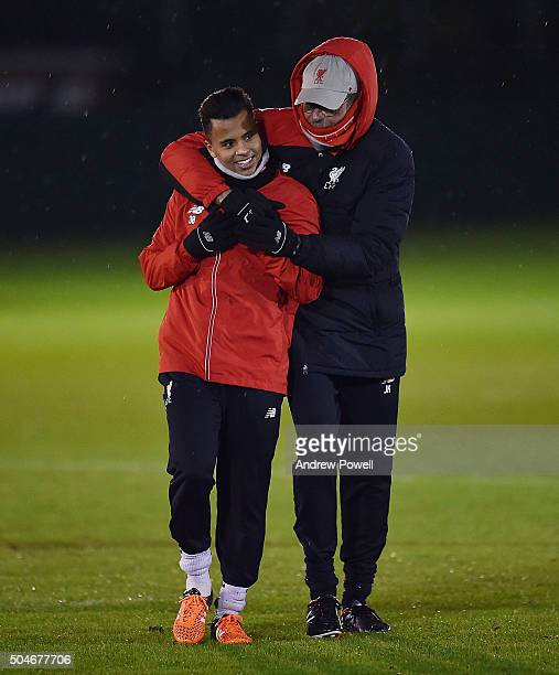 Jurgen Klopp manager of Liverpool talks with Allan Rodrigues de Souza during a training session at Melwood Training Ground on January 12 2016 in...