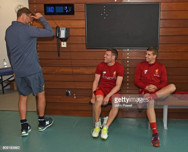 Jurgen Klopp manager of Liverpool talks with James Milner and Jon Flanagan during a training session at Melwood Training Ground on July 5 2017 in...