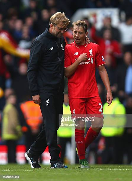 Jurgen Klopp manager of Liverpool talks with Lucas Leiva after replacing him during the Barclays Premier League match between Tottenham Hotspur and...