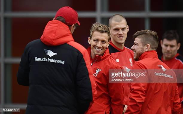 Jurgen Klopp manager of Liverpool talks with Lucas Leiva and Alberto Moreno during a training session at Melwood Training Ground on December 5 2015...