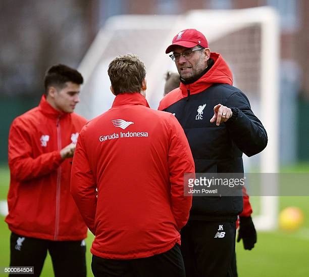Jurgen Klopp manager of Liverpool talks with Lucas Leiva during a training session at Melwood Training Ground on December 5 2015 in Liverpool England