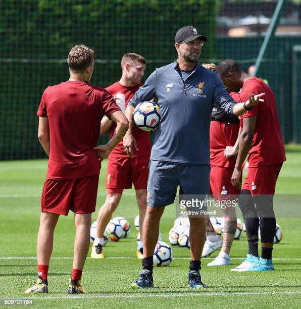 Jurgen Klopp manager of Liverpool talks with Lucas Leiva during a training session at Melwood Training Ground on July 6 2017 in Liverpool England