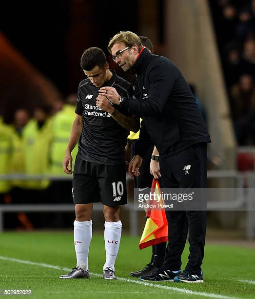 Jurgen Klopp manager of Liverpool talks with Philippe Coutinho during the Barclays Premier League match between Sunderland and Liverpool at the...