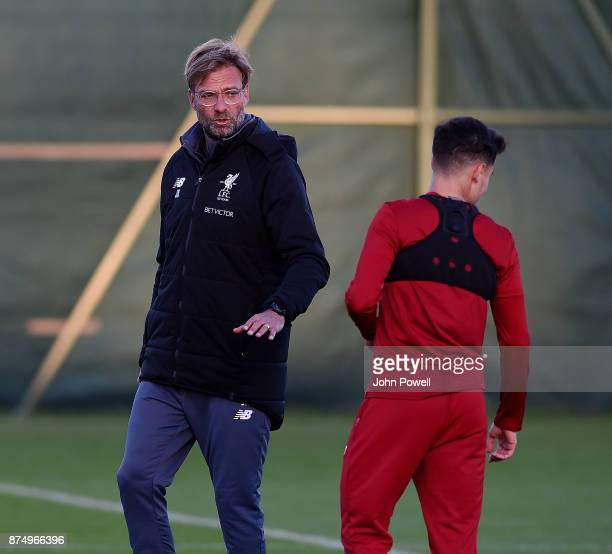 Jurgen Klopp manager of Liverpool talks with Philppe Coutinho during a training session at Melwood Training Ground on November 16 2017 in Liverpool...