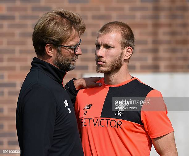 Jurgen Klopp manager of Liverpool talks with Ragnar Klavan during a training session at Melwood Training Ground on August 16 2016 in Liverpool England