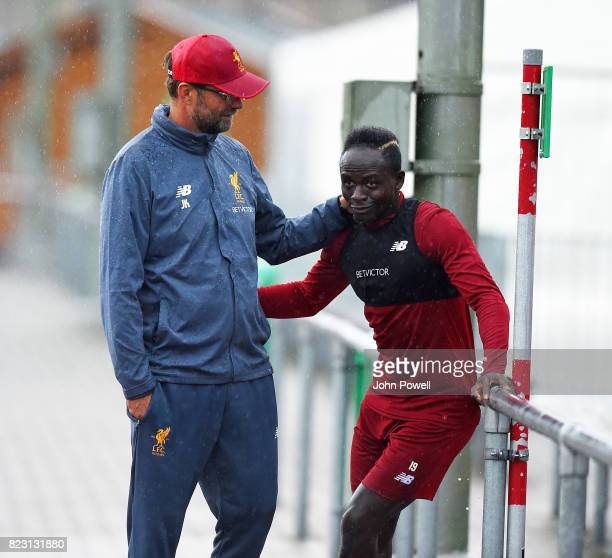 Jurgen Klopp manager of Liverpool talks with Sadio Mane during a training session at RottachEgern on July 26 2017 in Munich Germany