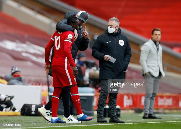 Jurgen Klopp, Manager of Liverpool talks with Sadio Mane of Liverpool before he is substituted on during the Premier League match between Liverpool...