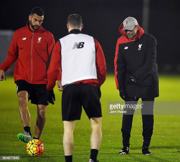 Jurgen Klopp manager of Liverpool talks with Steven Caulker and Brad Smith during a training session at Melwood Training Ground on January 12 2016 in...