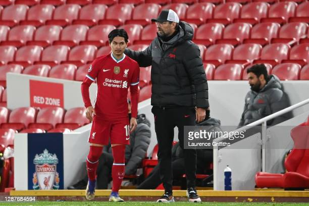 Jurgen Klopp, Manager of Liverpool talks with Takumi Minamino of Liverpool before coming on during the UEFA Champions League Group D stage match...