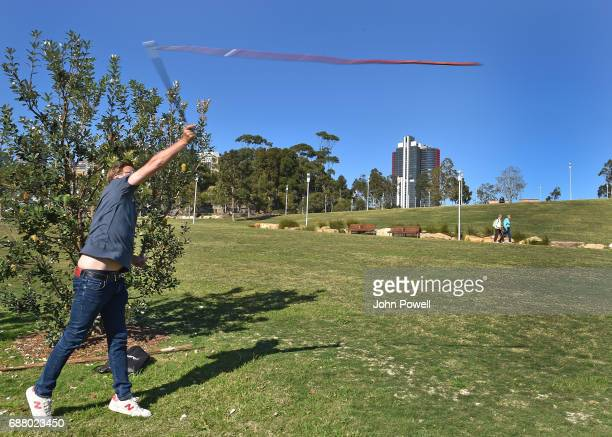 Jurgen Klopp manager of Liverpool throws the Gulka during a Aboriginal culture tour on Walumil Lawn on May 25 2017 in Sydney Australia