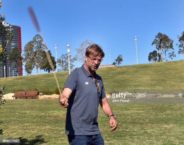 Jurgen Klopp manager of Liverpool turning the bullroare during a Aboriginal culture tour on Walumil Lawn on May 25 2017 in Sydney Australia