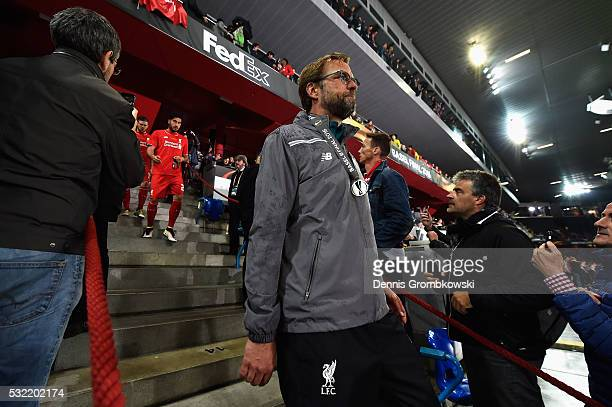 Jurgen Klopp manager of Liverpool walks after receiving the runnersup medal at the award ceremony after the UEFA Europa League Final match between...