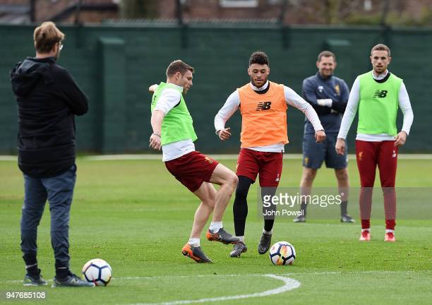 Jurgen Klopp manager of Liverpool watches James Milner and Alex OxladeChamberlain of Liverpool during a training session at Melwood Training Ground...