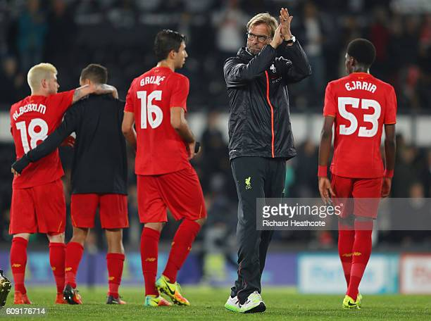 Jurgen Klopp Manager of Liverpool waves to supporters following victory in the EFL Cup Third Round match between Derby County and Liverpool at iPro...