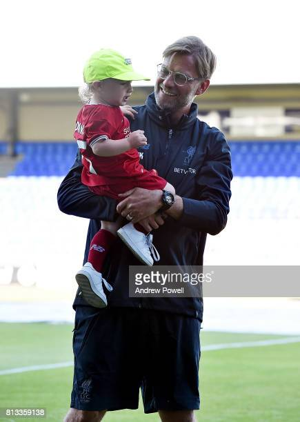 Jurgen Klopp manager of Liverpool with a fan before the pre season friendly between Tranmere Rovers and Liverpool at Prenton Park on July 12 2017 in...