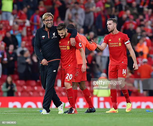 Jurgen Klopp manager of Liverpool with Adam Lallana at the end of the Premier League match between Liverpool and Leicester City at Anfield on...