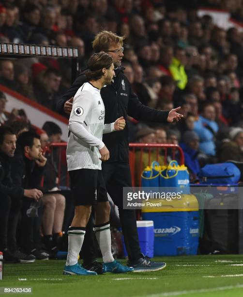 Jurgen Klopp manager of Liverpool with Adam Lallana during the Premier League match between AFC Bournemouth and Liverpool at Vitality Stadium on...