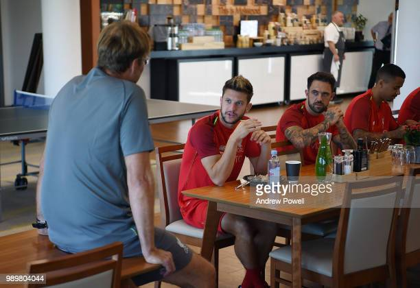 Jurgen Klopp manager of Liverpool with Adam Lallana during their first day back for preseason training at Melwood Training Ground on July 2 2018 in...