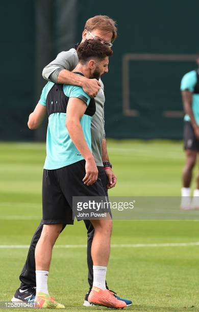 Jurgen Klopp manager of Liverpool with Adam Lallana of Liverpool during a training session at Melwood Training Ground on July 24 2020 in Liverpool...