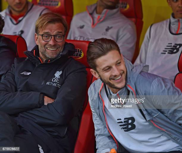 Jurgen Klopp Manager of Liverpool with Adam Lallana of Liverpool at the start of the Premier League match between Watford and Liverpool at Vicarage...