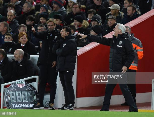 Jurgen Klopp Manager of Liverpool with Alan Pardew Manager of West Brom during the Premier League match between Liverpool and West Bromwich Albion at...