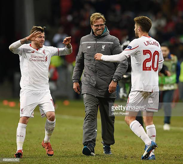 Jurgen Klopp manager of Liverpool with Alberto Moreno and Adam Lallana at the end of the UEFA Europa League match between FC Rubin Kazan and...