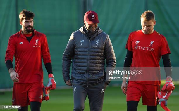 Jurgen Klopp manager of Liverpool with Alisson Becker and Simon Mignolet during a training session at Melwood Training Ground on October 18 2018 in...