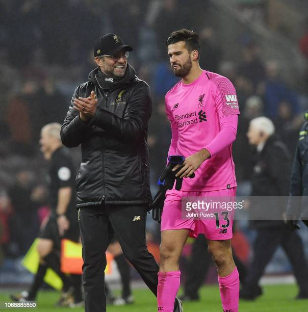 jurgen Klopp Manager of Liverpool with Alisson Becker at the end of the Premier League match between Burnley FC and Liverpool FC at Turf Moor on...