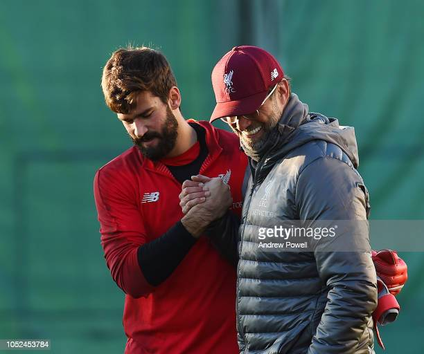 Jurgen Klopp manager of Liverpool with Alisson Becker during a training session at Melwood Training Ground on October 18 2018 in Liverpool England