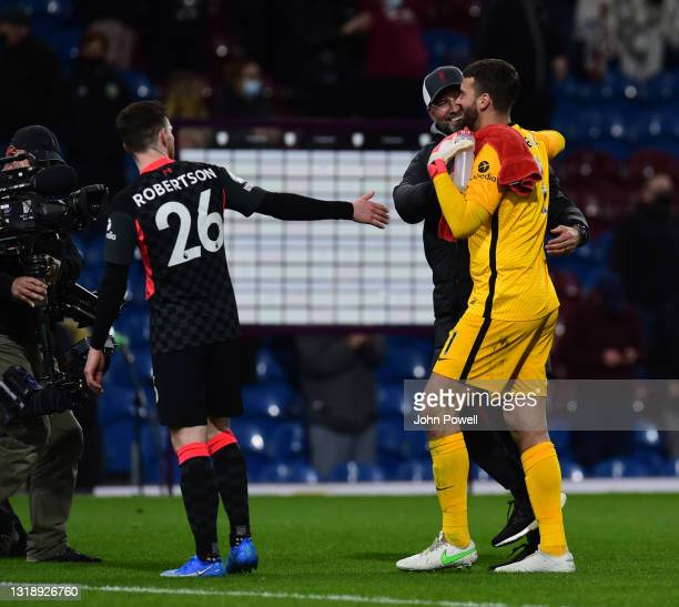 Jurgen Klopp manager of Liverpool with Alisson Becker of Liverpool at the end of the Premier League match between Burnley and Liverpool at Turf Moor...