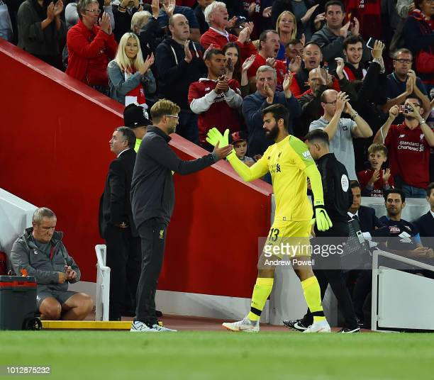 Jurgen Klopp manager of Liverpool with Alisson Becker of Liverpool shows his appreciation to the fans at the end of during the PreSeason friendly...