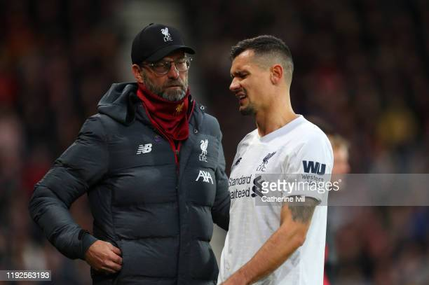 Jurgen Klopp manager of Liverpool with an injured Dejan Lovren of Liverpool during the Premier League match between AFC Bournemouth and Liverpool FC...