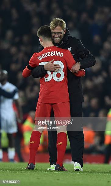 Jurgen Klopp manager of Liverpool with Ben Woodburn at the end of the EFL Cup QuarterFinal match between Liverpool and Leeds United at Anfield on...