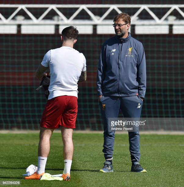 Jurgen Klopp manager of Liverpool with Danny Ings during a training session at Melwood Training Ground on April 5 2018 in Liverpool England