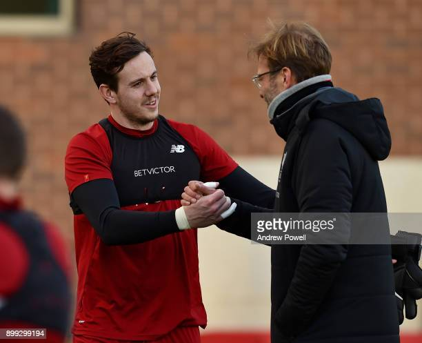 Jurgen Klopp manager of Liverpool with Danny Ward during a training session at Melwood Training Ground on December 28 2017 in Liverpool England