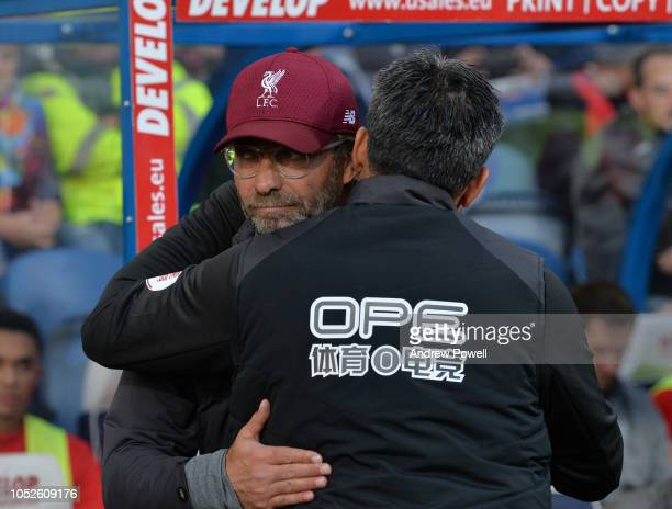 Jurgen KLopp Manager of Liverpool with David Wagner Manager of Huddersield Town during the Premier League match between Huddersfield Town and...