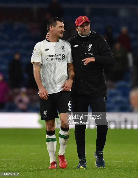 Jurgen Klopp manager of Liverpool with Dejan Lovren at the end of the Premier League match between Burnley and Liverpool at Turf Moor on January 1...