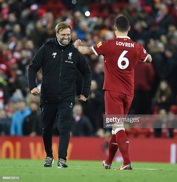 Jurgen Klopp Manager of Liverpool with Dejan Lovren celebrates the win at the end of the Premier League match between Liverpool and Leicester City at...