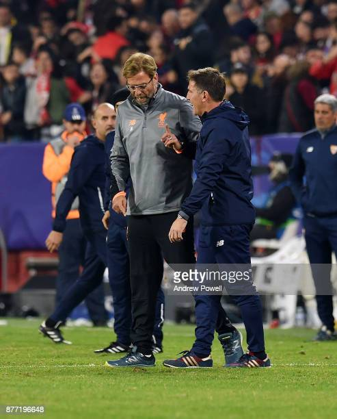 Jurgen Klopp manager of Liverpool with Eduardo Berizzo manager of Sevilla FC at the end of the UEFA Champions League group E match between Sevilla FC...