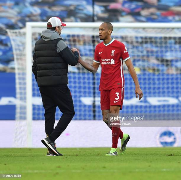 Jurgen Klopp manager of Liverpool with Fabinho of Liverpoolat the end of the Premier League match between Brighton & Hove Albion and Liverpool at...