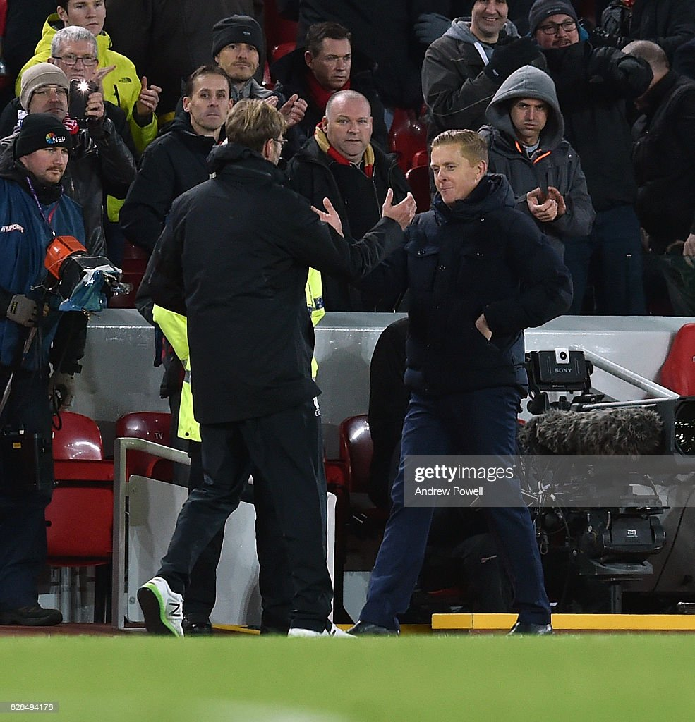 Jurgen Klopp Manager of Liverpool with Garry Monk Manager of Leeds at the end of the EFL Cup Quarter-Final match between Liverpool and Leeds United at Anfield on November 29, 2016 in Liverpool, England.
