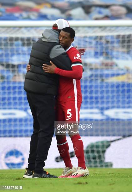 Jurgen Klopp manager of Liverpool with Georginio Wijnaldum of Liverpool at the end of the Premier League match between Brighton & Hove Albion and...