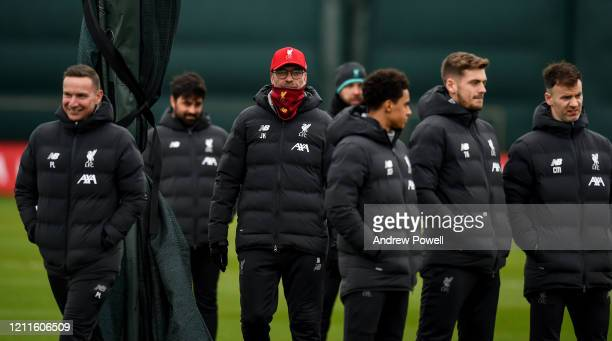 Jurgen Klopp manager of Liverpool with his backroom staff during a training session at Melwood training ground on March 10 2020 in Liverpool United...