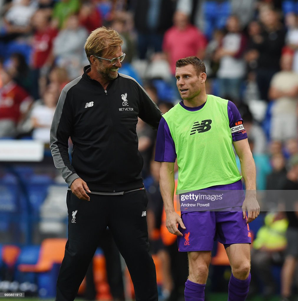 Jurgen Klopp manager of Liverpool with James Milner at the end of the pre-season friendly match between Tranmere Rovers and Liverpool at Prenton Park on July 10, 2018 in Birkenhead, England.